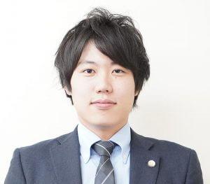 弁護士小村良之の顔写真